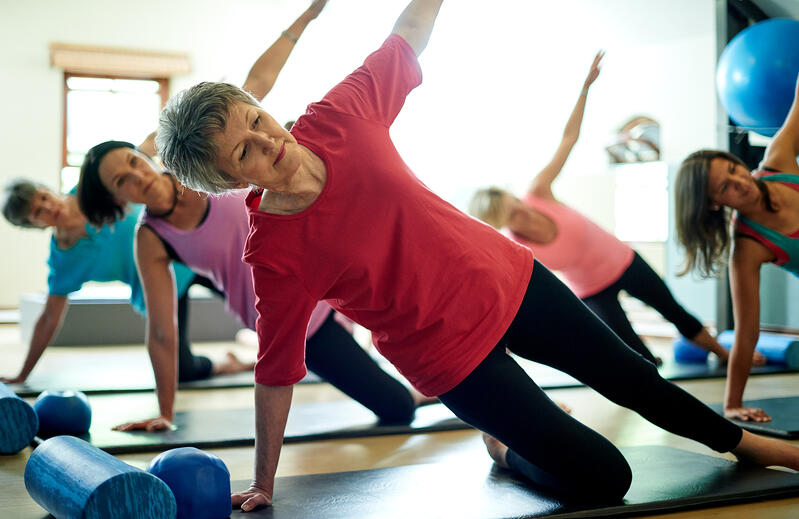 Retired Women Doing A Pilates Exercise Class